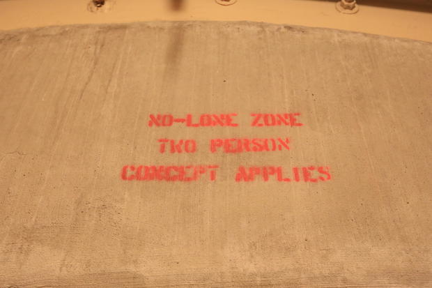 8-photo-credit-jake-barlow-no-lone-zone-stencil-over-door.jpg