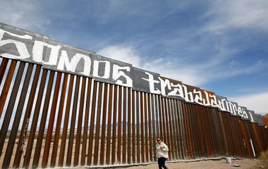 Companies bid for Trump's border wall, and other MoneyWatch headlines