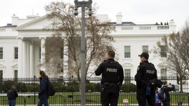 Members of the Secret Service Uniformed Division patrol alongside the security fence around the perimeter of the White House in Washington March 18, 2017.