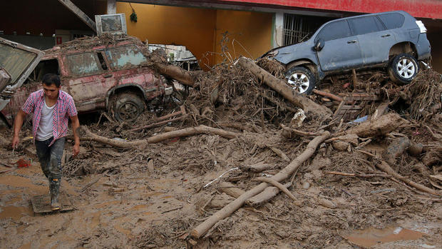 Torrent of floodwaters sweeps through Colombian town