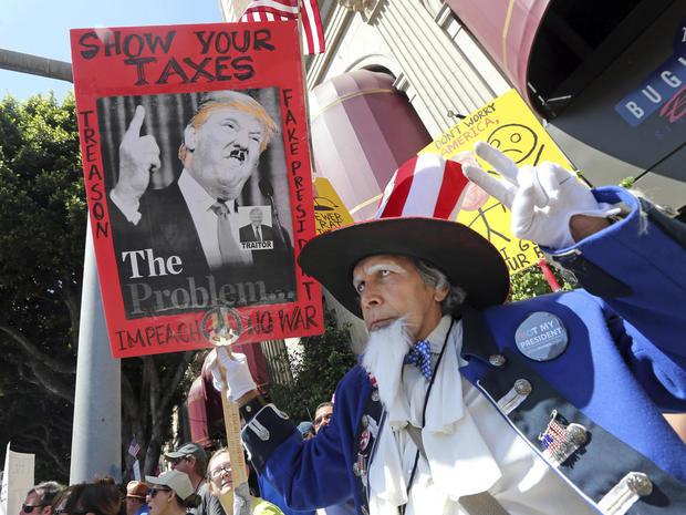 tax-day-marches-ap-17105796831825.jpg