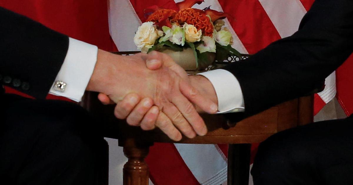 Trump Macron Handshake Turns Into Showdown Cbs News