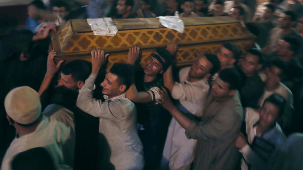 Mourners carry a coffin at the funeral of Coptic Christians who were killed in Minya, Egypt, May 26, 2017.