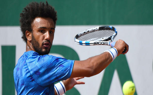 France's Maxime Hamou returns the ball to Uruguay's Pablo Cuevas during their tennis match at Roland Garros at the French Open on May 29, 2017, in Paris.