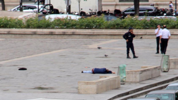 A man lies on the ground outside Notre Dame Cathedral after attacking police officers in Paris on June 6, 2017, in this picture provided to CBS News.