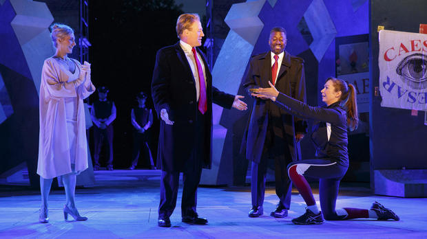 Tina Benko, left, portrays Melania Trump in the role of Caesar's wife, Calpurnia, and Gregg Henry, center left, portrays President Trump in the role of Julius Caesar during a dress rehearsal of The Public Theater's Free Shakespeare in the Park production