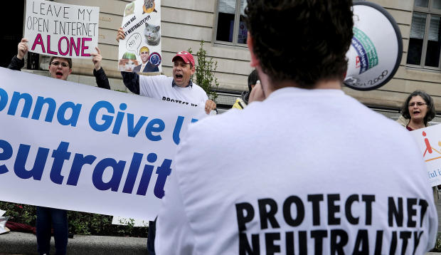 Proponents of net neutrality protest against Federal Communication Commission Chairman Ajit Pai outside the American Enterprise Institute before his arrival May 5, 2017, in Washington.