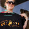 Melissa Howe displays one of her eclipse t-shirts designs in Guernsey