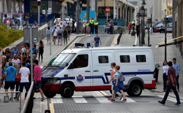 A police van blocks the the street at the beginning of fiestas in Bilbao