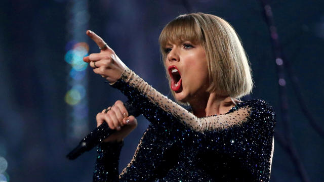 """FILE PHOTO: Taylor Swift performs """"Out of the Woods"""" at the 58th Grammy Awards in Los Angeles"""