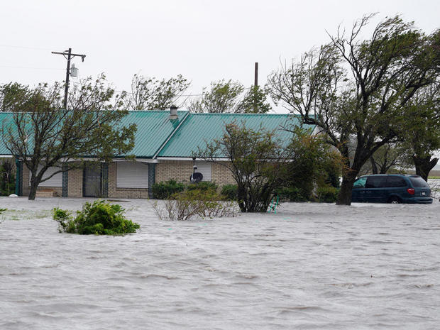 A ranch house is surrounded by floodwaters from Hurricane Harvey near Port Lavaca