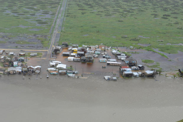 Housing surrounded by flood waters is seen from a U.S. Coast Guard helicopter during an overflight from Port Aransas to Port O'Connor