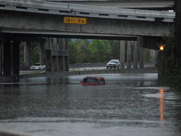 An abandoned Hummer is covered in floodwaters on Interstate 610 after Hurricane Harvey inundated the Texas Gulf coast with rain, in Houston