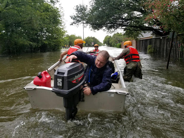 Handout photo of Texas National Guard soldiers search by boat for stranded residents in heavily flooded areas from the storms of Hurricane Harvey in Houston