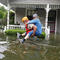 Handout photo of a Texas National Guard soldier carries a woman on his bank as they conduct rescue operations in flooded areas around Houston