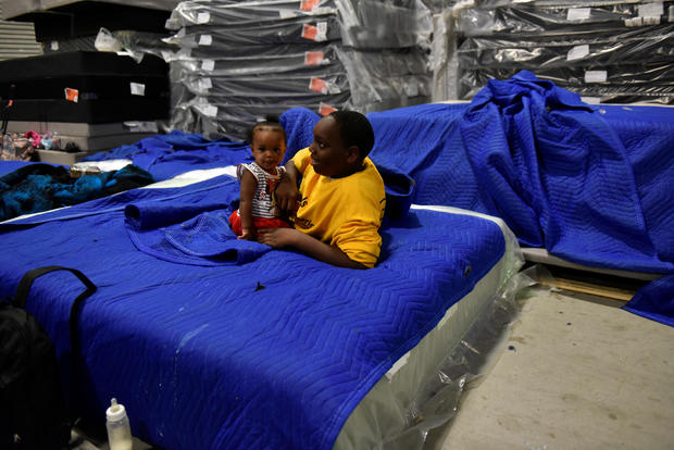 Harvey evacuees seen in the warehouse at Gallery Furniture in Houston