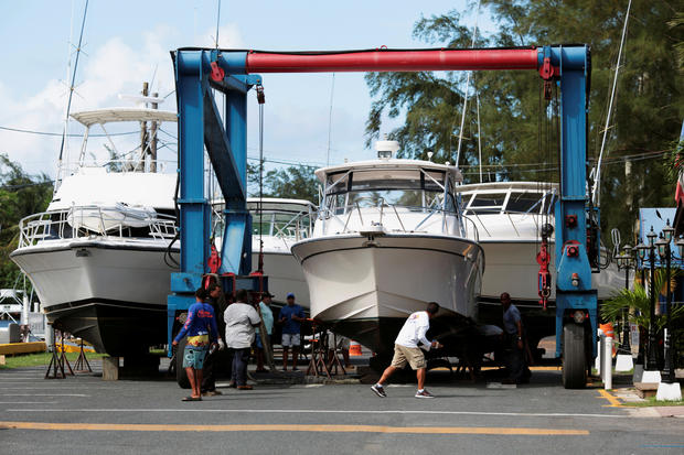 Workers put boats on dry docks in preparation, as Hurricane Irma, barreling towards the Caribbean and the southern United States, was upgraded to a Category 4 storm, in San Juan