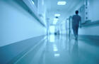 Blurred medical background. Moving human figure in the hospital corridor.