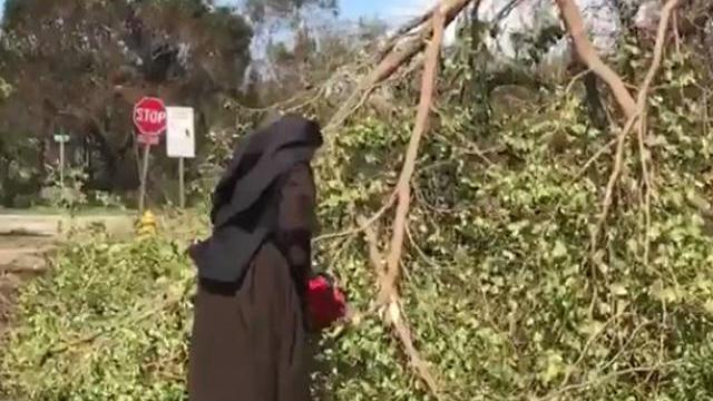 nun-grabs-chain-saw-to-clear-trees-in-miami-post-irma-0917.jpg