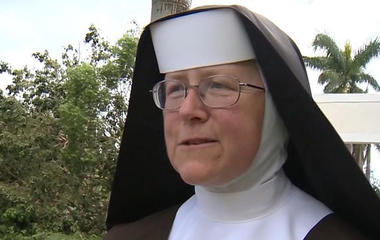 Nun clears downed trees from Irma with a chainsaw