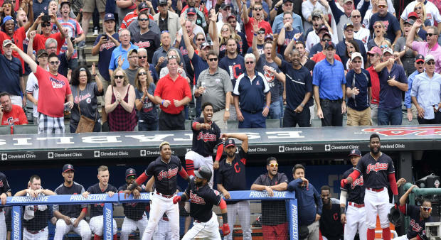 The Cleveland Indians celebrate as first baseman Carlos Santana (41) rounds third base on an attempted inside-the-park home run in the eighth inning against the Detroit Tigers at Progressive Field in Cleveland on Sept. 13, 2017. Santana was tagged out at