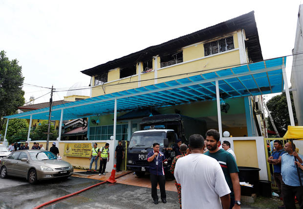 Authorities work at religious school Darul Quran Ittifaqiyah after a fire broke out in Kuala Lumpur