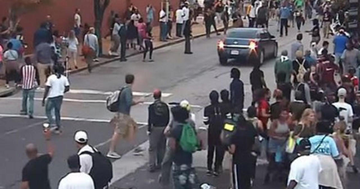 St Louis police car backs up toward protesters its on video