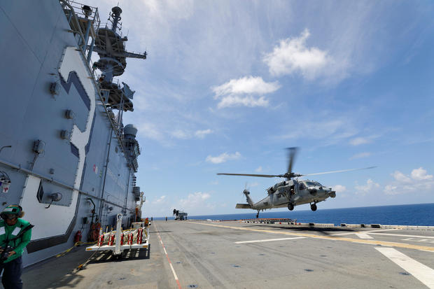 A Navy MH-60S Sea Hawk lifts off from the flight deck of the USS Kearsarge as U.S. military continues to evacuate from the U.S. Virgin Islands in advance of Hurricane Maria