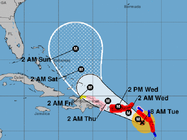 "A map shows the probable path for Hurricane Maria as of 8 a.m. ET on Sept. 19, 2017. The M stands for ""major hurricane."" The red areas represent hurricane warnings. The blue areas represent tropical storm warnings. The pink areas represent hurricane watches. The yellow areas represent tropical storm watches."