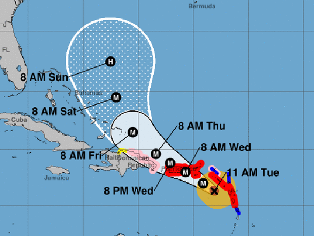 "A map shows the probable path for Hurricane Maria as of 11 a.m. ET on Sept. 19, 2017. The M stands for ""major hurricane."" The red areas represent hurricane warnings. The blue areas represent tropical storm warnings. The pink areas represent hurricane watches. The yellow areas represent tropical storm watches."