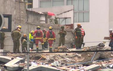 Victims still trapped under collapsed school