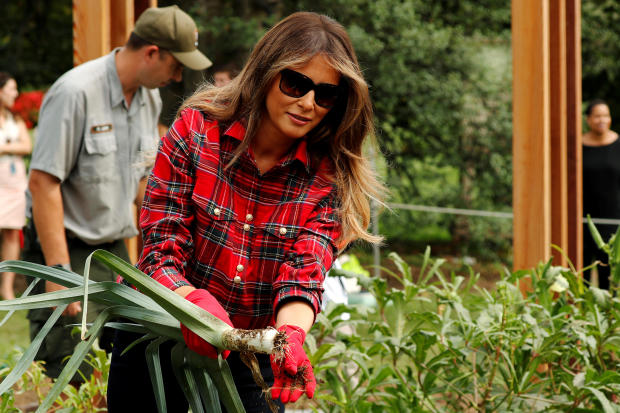 Melania Trump works in the White House garden with students from the Boys and Girls Clubs at the White House in Washington