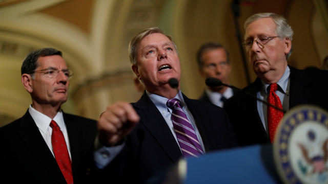 Sen. Lindsey Graham (R-SC) speaks with reporters following the party luncheons on Capitol Hill in Washington