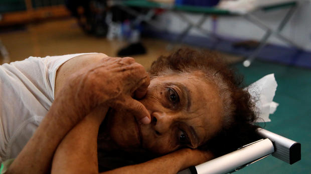 Hilda Colon wakes up after sleeping in a shelter set up at the Pedrin Zorrilla coliseum after the area was hit by Hurricane Maria in San Juan, Puerto Rico, Sept. 25, 2017.