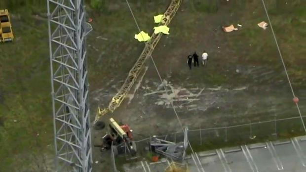 Aerial footage shows crews working the scene after three workers fell from a transmission tower in Miami Gardens, Florida, on Sept. 27, 2017.