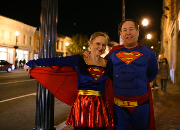 A couple with the Superman and Supergirl