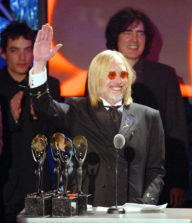 Inductee Tom Petty waves as he and his band The He
