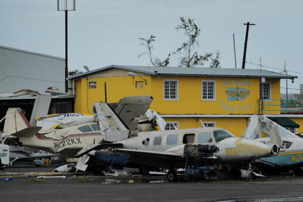 Damaged planes stand piled up near the airport of Isla Grande