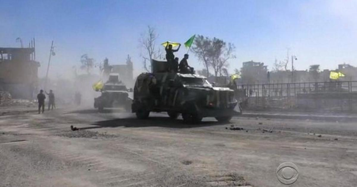Militias declare victory in city ISIS considered its capital - Videos - CBS News