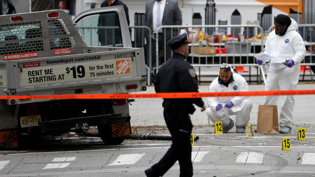 Law Enforcement officials investigate a pickup truck used in an attack on the West Side Highway in lower Manhattan in New York