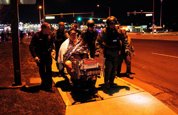Patrick Carnes is evacuated in a Walmart cart by SWAT medics from the scene of a shooting at a Walmart where Carnes was shopping in Thornton