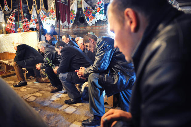 Romanian believers pray during the Palm