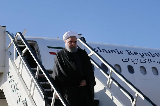 Iranian President Hassan Rouhani walks down aircraft steps as he arrives at Kermanshah that was hit by a powerful earthquake