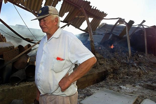 Farm owner Neville Tapson walks through the burnin