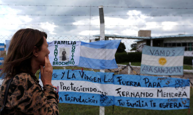 A woman looks at signs in support of the missing crew members of the ARA San Juan submarine in Mar del Plata