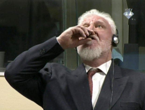 A wartime commander of Bosnian Croat forces, Slobodan Praljak, is seen during a hearing at the U.N. war crimes tribunal in the Hague, Netherlands, Nov. 29, 2017.