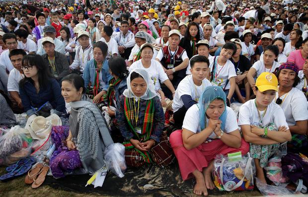 Catholic faithful attend a mass led by Pope Francis at Kyite Ka San Football Stadium in Yangon, Myanmar