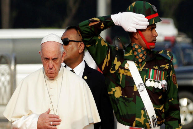Pope Francis attends a welcome ceremony after arriving at the airport in Dhaka, Bangladesh, Nov. 30, 2017.