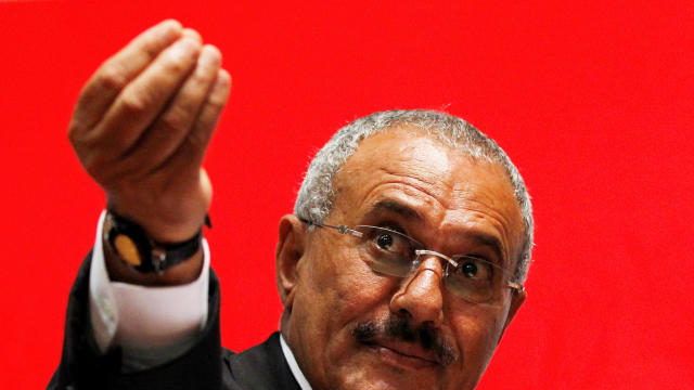 Yemen's then-President Ali Abdullah Saleh gestures during a gathering of supporters in Sanaa Feb. 20, 2011.