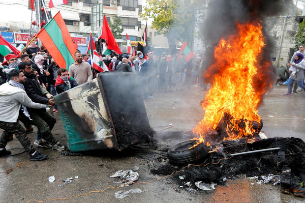 Protesters are seen near the U.S. embassy in Awkar, in Beirut
